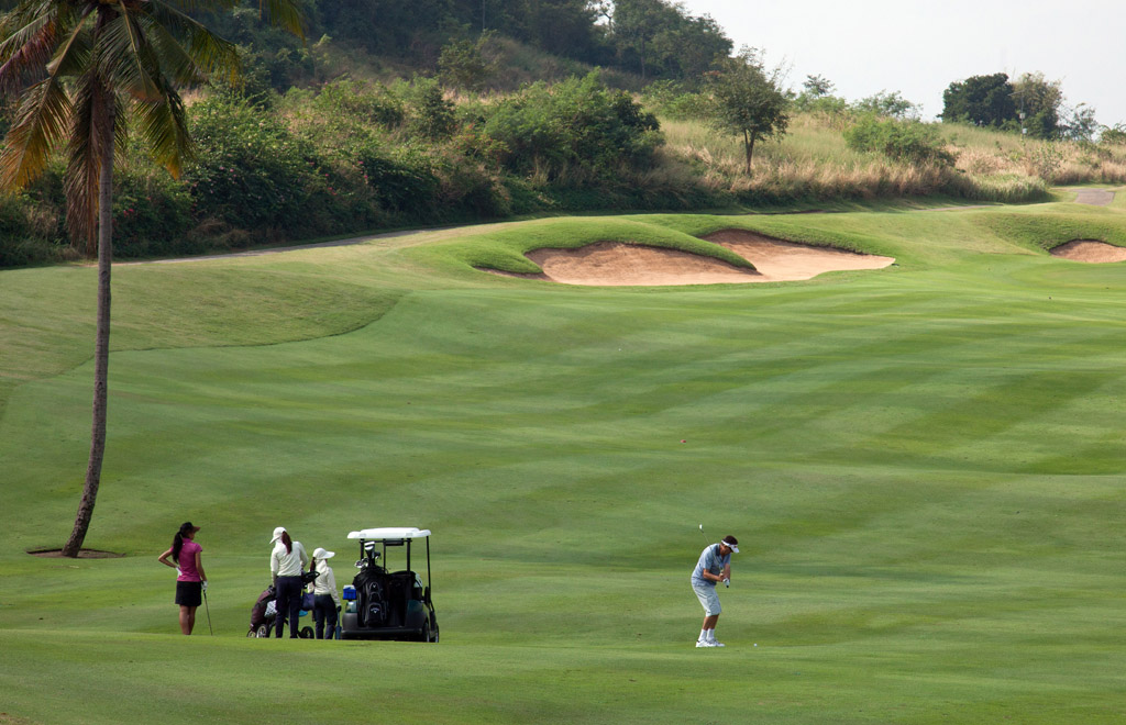 Players and golf buggy, Banyan golf course.
