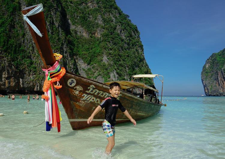 Phuket With Kids-Phuket-MayaBeah-PhiPhiIslands-LongtailBoat-Boy