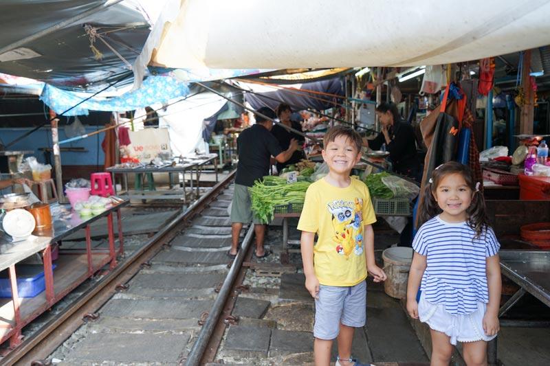 BangkokwithKids-MaeklongRailwayMarket-Kids-Tracks