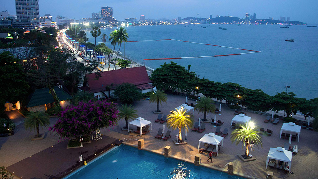 Pattaya Bay by dusk, looking south from Dusit Thani hotel. Copyright John Borthwick