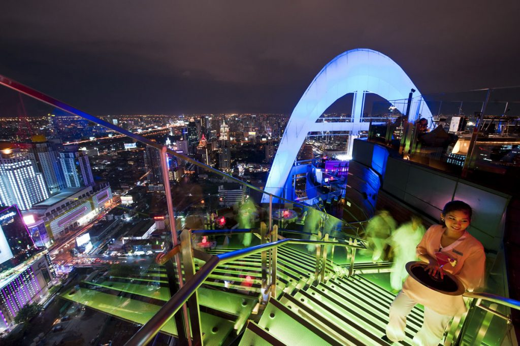 Bangkok Best rooftop Bars Grand & Bangkok Convention Centre at CentralWorld - Red Sky blue lit with waitress